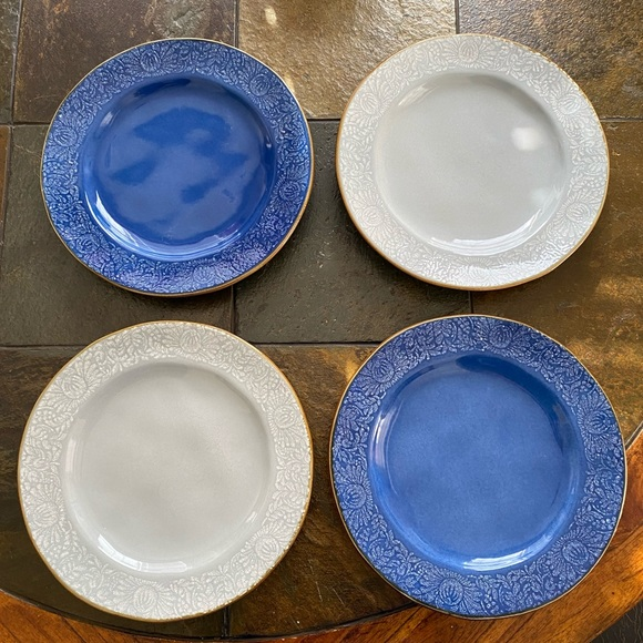 "Set of four dinner plates. 11"" Dia. Blue. Design."